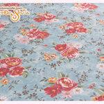 ผ้าคอตตอนไทยลายดอกไม้พื้นสีฟ้า